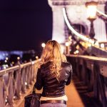 Blonde Girl Walking on Chain Bridge in Budapest
